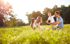 Header-Family-Laying-in-Field